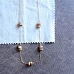Ras de cou aux fines perles de bois